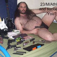 Fat hairy man in a speedo with guns and Guitar Hero controllers