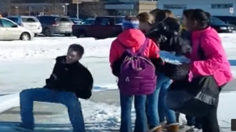 Dad Laughs as Kids Fall on Ice