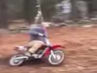 Father Swings While Riding a Motorbike