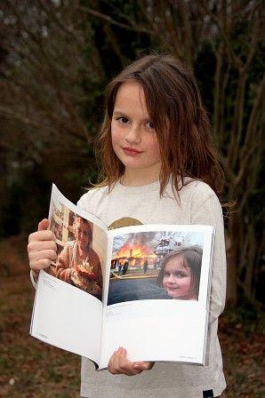disaster-girl-with-her-photo.jpg