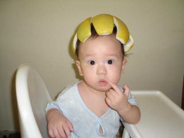 Chinese Baby Wearing Pomelo Rind