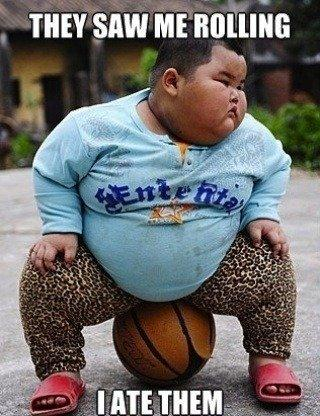 Lu Hao sitting on basketball