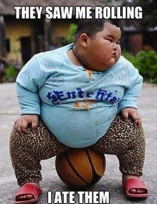 Lu Hao sitting on basketball