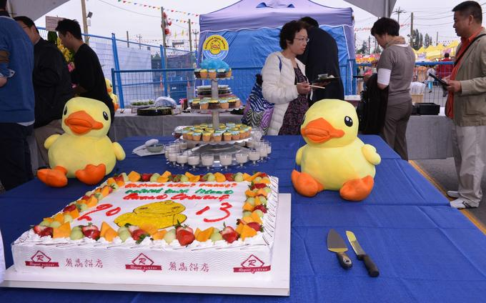 Big Yellow Duck plush toys and cake