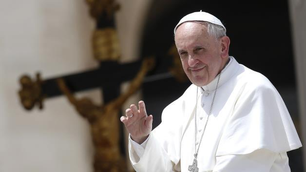 Pope Francis holding a bazooka